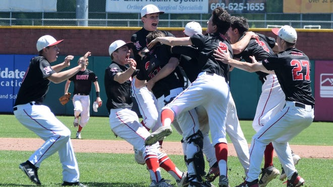 The Newmarket High School baseball teams swarms Northeast Delta Dental Stadium after beating Pittsfield for the 2019 Division IV state championship.