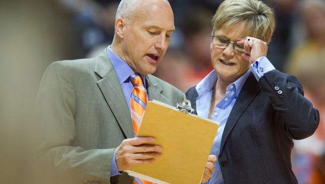 Tennessee head coach Holly Warlick talks with assistant coach Dean Lockwood during the game against Alabama State at Thompson-Boling Arena on Sunday, December 3, 2017.