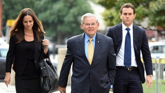 Democratic Sen. Bob Menendez arrives at Martin Luther King Jr. Federal Court in Newark with his children Alicia and Robert on the opening day of his trial on public corruption charges.