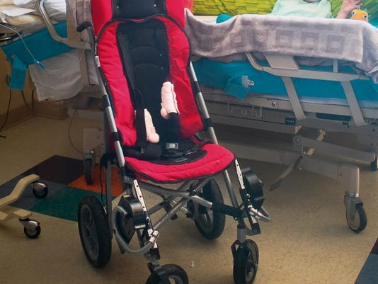 Six-year-old Dominique Perriguey's custom-made EZ Rider Mobility Stroller is seen here Thursday at Memorial Medical Center in Las Cruces. The stroller, which costs nearly 2,000, was stolen in May and recovered by the Doña Ana County Sheriff's Office earlier this week.