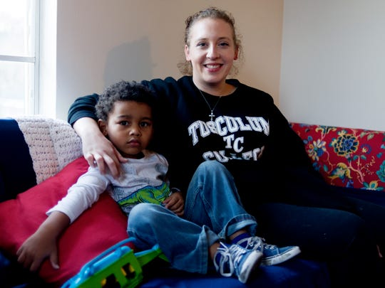 Sarah Engle and her son Jaivion, 4, sit at their Knoxville apartment, which Engle is renting with help from the Elizabeth's Homes transitional housing program.