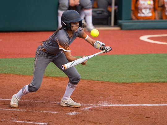 Beeville's Allie Estrada bunts during the first inning of the 4A state semifinal game against Liberty High School at McCombs Field in Austin on Thursday, May 31, 2018.