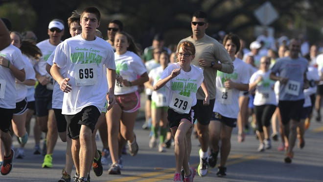 Gulf Breeze High School received recognition from the Florida Department of Education for the Quentin Cooper Liver Life 5K project. This is a file photo from the 2013 race.