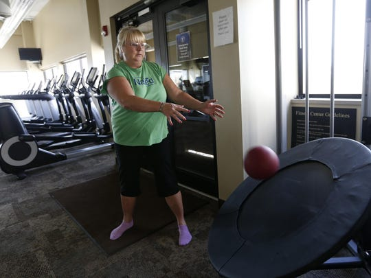 Lauri Wright with VGM Club works out in the employee gym Tuesday, Aug. 4, 2015, in Waterloo. Wright said she comes three times a week to work out in the gym, which is free for employees and their families.