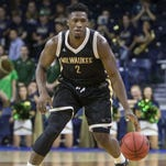 Milwaukee's Akeem Springs (2) moves the ball down court during the second half of a Nov. 17, 2015, game in South Bend, Ind. Springs has joined Minnesota this season as a graduate transfer.