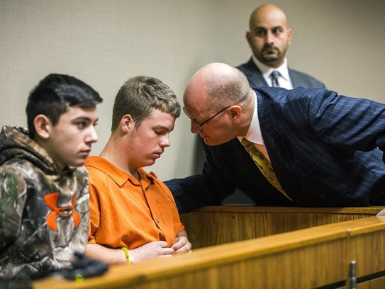 Kyle Anger speaks with his lawyer as Mikadyn Payne,