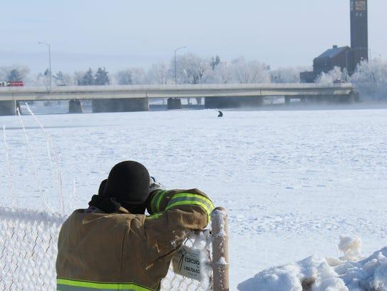 A Great Falls Fire Rescue service personnel follows