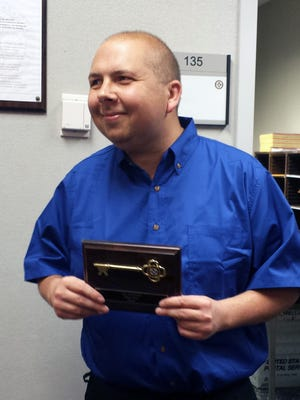 Shawn Webb received the key to Fairfield after passing out more than 70 Mother's Day cards in the foyer of the Fairfield Kroger store where he is a bagger.