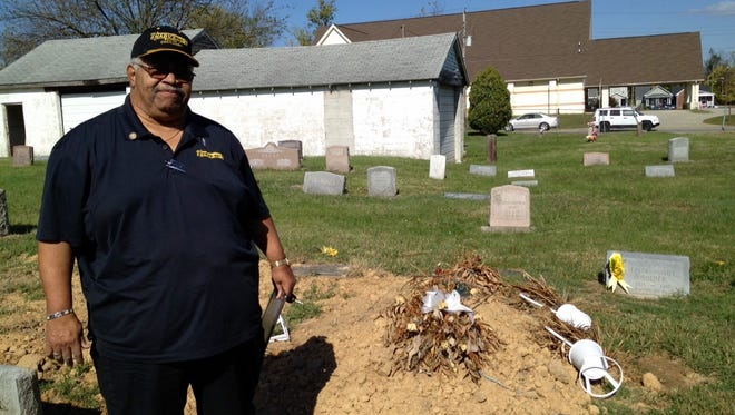 National Association of Black Veterans regional leader Shedrick Jones has formed a task force to help with neglected cemeteries, such as Greenwood, shown, in west Louisville.