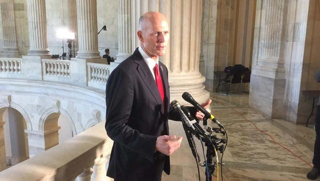 Florida GOP Gov. Rick Scott speaks to reporters March 9, 2017, on Capitol Hill in between meetings with lawmakers to share his views on the Republican bill to replace the Affordable Care Act.