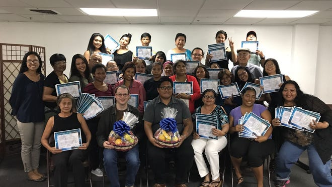 A group of participants from the Guam Dept. of Public Health and Social Services, JOBS and GETP programs pose with NH Guam trainers and staff after completing a 6-day Microsoft Office Bootcamp on Sept. 7 at New Horizons Computer Training and Certification Guam. The Bootcamp consisted of training in Microsoft Office Applications Excel and Word.
