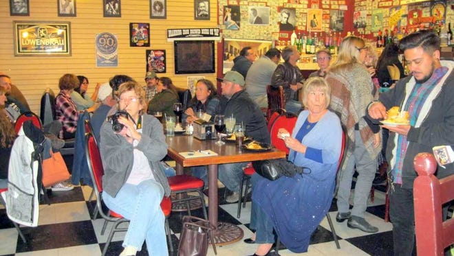 People gather to discuss the 23rd annual Silver City Blues Festival at Q's Southern Bistro on Wednesday.