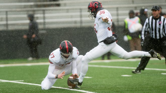 With Steven Coutts holding, UL's Stevie Artigue kicks one of his three field goals in a Dec. 3 win at UL Monroe that helped put the Ragin' Cajuns into Saturday's New Orleans Bowl.