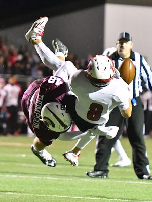Ben Brabender is hit hard as he tries to catch a pass in the first half. Turpin's Colin Thompson made the play.
