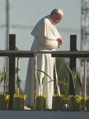 Pope Francis offered a brief prayer at the U.S.-Mexico border during a visit Wednesday to Juárez.