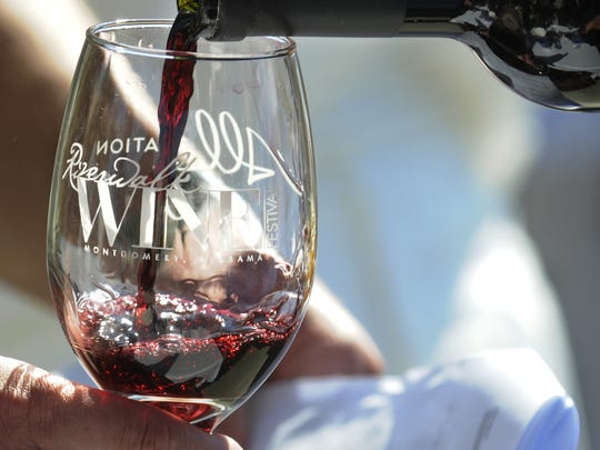 People enjoy wine samples during Riverwalk Wine Festival.