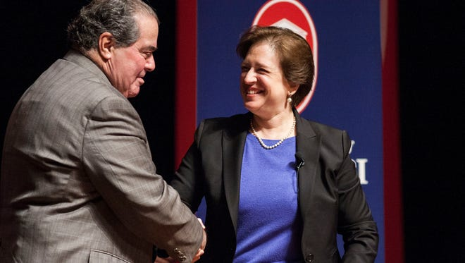 Supreme Court Justices Antonin Scalia and Elena Kagan shake hands following their appearance at Ole Miss.
