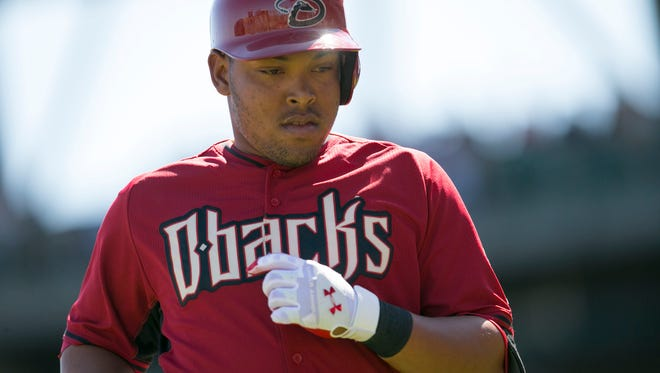 Diamondbacks' Yasmany Tomas heads back to the dugout during a game against the Athletics at Salt River Fields at Talking Stick on March 6, 2015.
