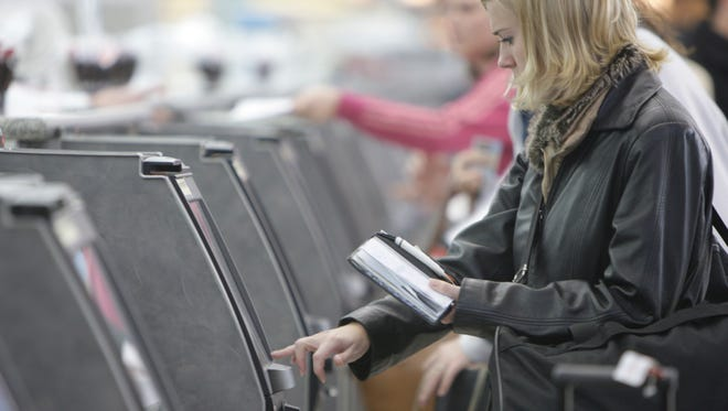 A traveler checks in for her flight at Lambert-St. Louis International Airport.