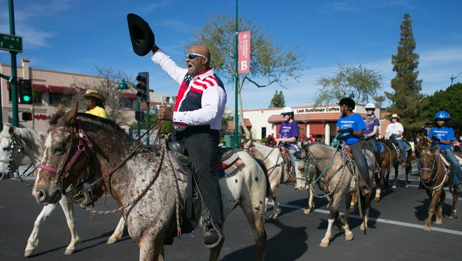 John Goodie participates in a parade earlier this year. He has been a powerful voice for racial equality in Mesa, helping disadvantaged youth as a volunteer football coach for 20 years at Mesa High School, using his imposing stature to keep Mesa's parks safe as a ranger and serving as a delegate to a Democratic National Convention.
