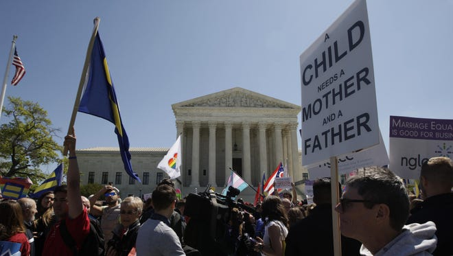 An anti-same-sex marriage protestor outside the Supreme Court.