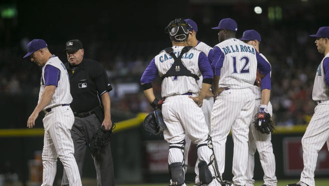 Diamondbacks manager Chip Hale leaves the mound after umpire Jim Joyce comes to interrupt a talk with pitcher Rubby De La Rosa at Chase Field in Phoenix, AZ on August 27, 2015.