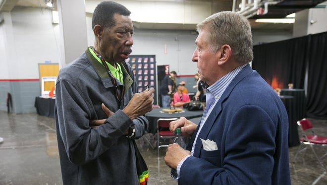 Late 1960s and early 1970s Suns legend Connie Hawkins talks with former Suns owner Jerry Colangelo at the Veterans Coliseum at the Arizona State Fairgrounds in Phoenix before the Suns' intra-team scrimmage at the Veterans Coliseum on Saturday, October 3, 2015. The Suns played in the Veterans Coliseum from their inaugural 1968 season until 1992.