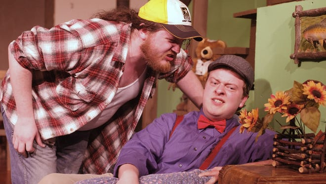 """Bryon Morris (top) and Kyle Doty rehearse for the Aumsville Community Theater production of """"The Foreigner"""" on May 14, 2014. The theater group is hosting a Murder Mystery Dinner fundraiser on Oct. 29-31 to help raise money to secure a permanent location."""