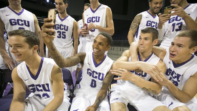 Grand Canyon University men's basketball players (from left in front) Adrian Carrion Armas, DeWayne Russell, Ryan Majerle and Gerard Martin pose for a selfie between official team photo shoots during the Grand Canyon University Men's Basketball Media Day at GCU Arena at Grand Canyon University in Phoenix on Wednesday, September 23, 2015.