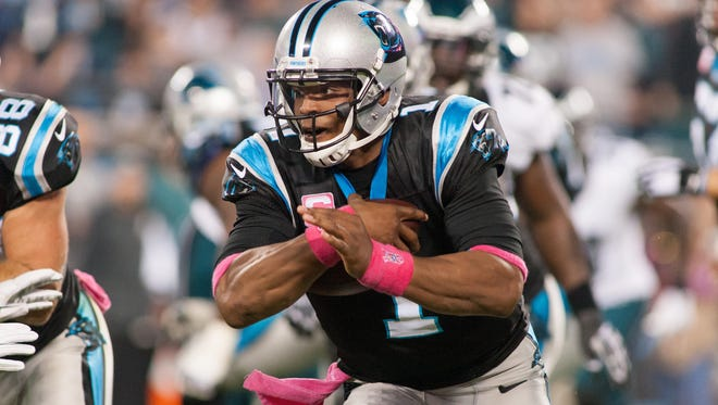 Carolina Panthers quarterback Cam Newton (1) runs the ball during the first quarter against the Philadelphia Eagles at Bank of America Stadium.