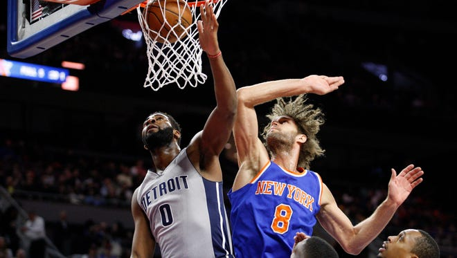 Pistons center Andre Drummond (0) makes a shot over Knicks center Robin Lopez (8) during the first quarter Thursday at the Palace.