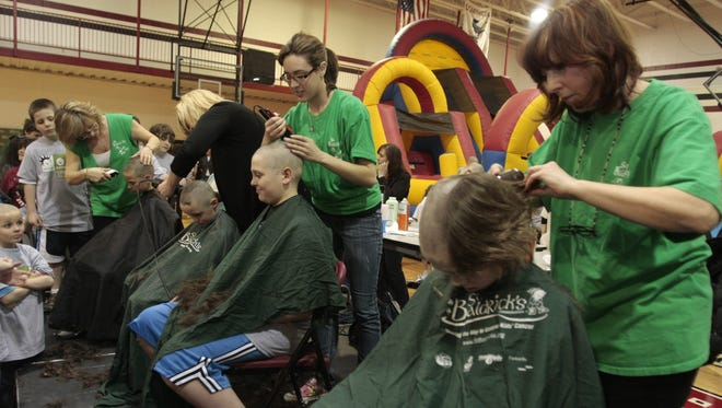 Participants get their heads shaved at the Hennessy Center at Dominican College in 2010 to benefit the St. Baldrick's Foundation