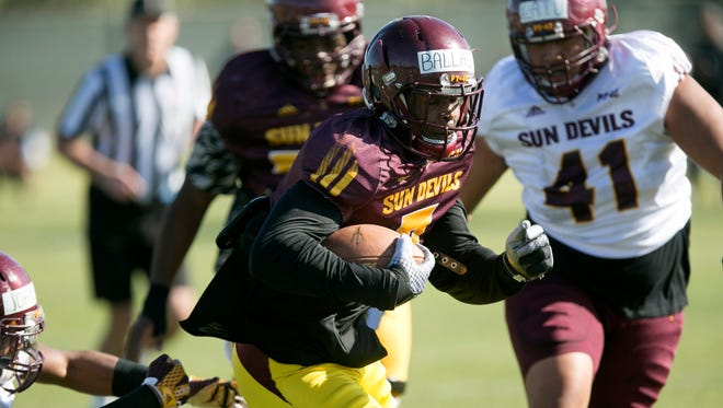ASU running back Kalen Ballage carries the ball during an ASU spring football practice at the ASU practice facility in Tempe on Friday, March 25, 2016.