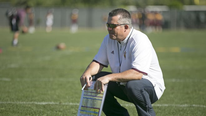 ASU head football coach Todd Graham looks on during Day 2 of ASU Spring football practice at the ASU practice facility in Tempe on Wednesday, March 16, 2016.