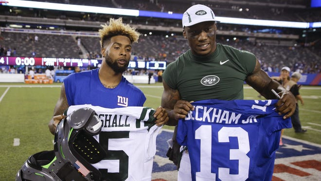 Giants wide receiver Odell Beckham Jr. (left) has a new teammate in Brandon Marshall (right). Marshall signed a two-year, $12 million deal with the Giants.