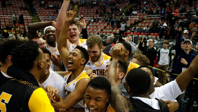 Northern Kentucky teammates celebrate their conference title.