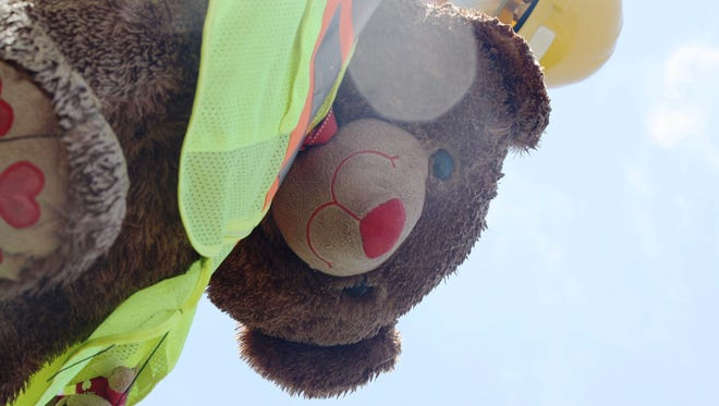 This bear with a safety jacket on became a memorial for Amber Rooks, a 24-year-old mother who was struck and killed by an impaired driver in 2015.