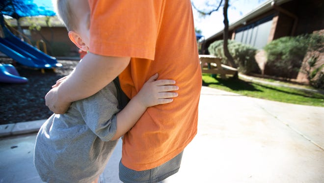 A 2-year-old boy hugs his 7-year-old brother at Child Crisis Arizona in Phoenix on Feb. 29, 2016. Children stay at the shelter an average of six to nine months.