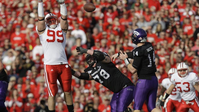 Quarterback Andy Dalton may not have as much success with the Chicago Bears than he did with TCU against J.J. Watt (99) and Wisconsin in the 2011 Rose Bowl.