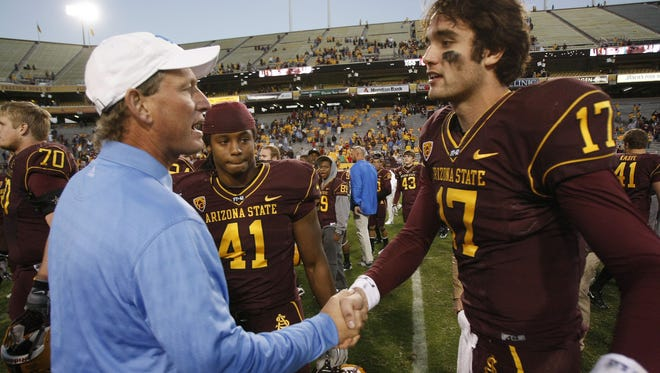 Arizona State quarterback Brock Osweiler is congratulated by UCLA head coach Rick Neuheisel  after a game in 2010.