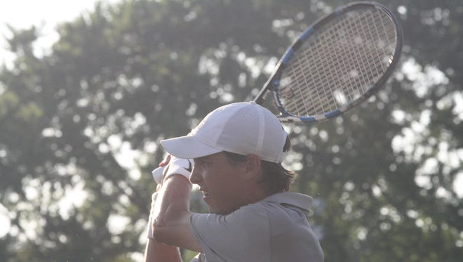 Tyler Fraser, a Little Miami High School grad, finishes a backhand shot in the men's open doubles final of the Thomas E. Price Cincinnati Metropolitan Tennis Tournament on Friday, July 13, 2018, at the Lindner Family Tennis Center at Lunken.