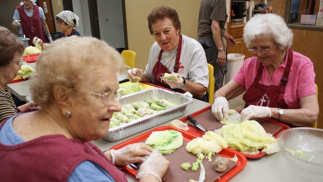 Volunteers from nine parishes formed an assembly line Wednesday morning to prepare 1,300 holupki for Sunday's St. Cyril's Parish Festival.