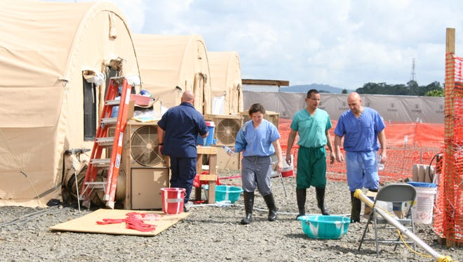 U.S. Public Health Service officers outside of the Monrovia Medical Unit.