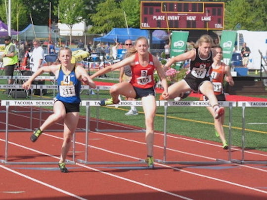 Bremerton's Lauryn Chandler (left) won the Class 2A girls 100-meter hurdles title Friday at the state track and field championships at Mount Tahoma High School.