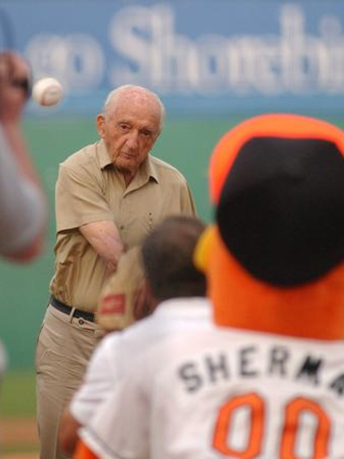 Frank Perdue throws out a first pitch to Sherman in