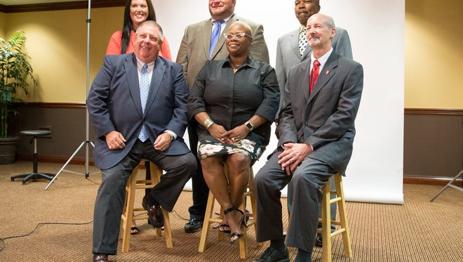 Brittany Bales, Jim Williams, Keith O'Neal (back row), Dave Heeter, WaTasha Barnes Griffin and Jim Lowe pose for their official portraits after being appointed to the Muncie Community School Board on Monday. A seventh member, Mark Ervin, is not pictured.