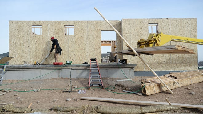 Construction continues in the Bucking Horse neighborhood on Thursday. The 12-month inventory of homes for sale is a third of what it was five years ago while median sale price has jumped more than 50 percent in that time.