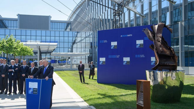 President Trump speaking at NATO headquarters in Brussels.