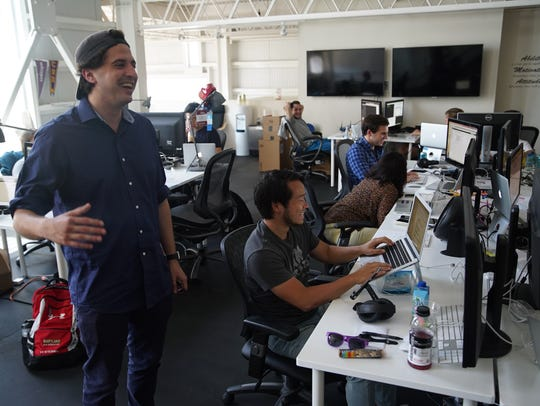 Whisper CEO Michael Heyward mingles with  staffers