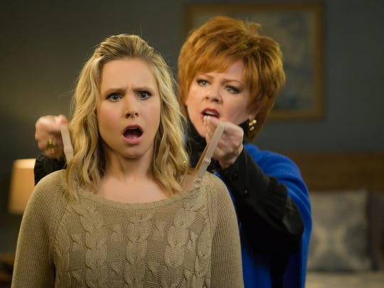 "Claire (left, Kristen Bell) gets some fashion advice from Michelle Darnell (Melissa McCarthy) in ""The Boss.""  McCarthy headlines the comedy as a titan of industry who is sent to prison after she's caught for insider trading."
